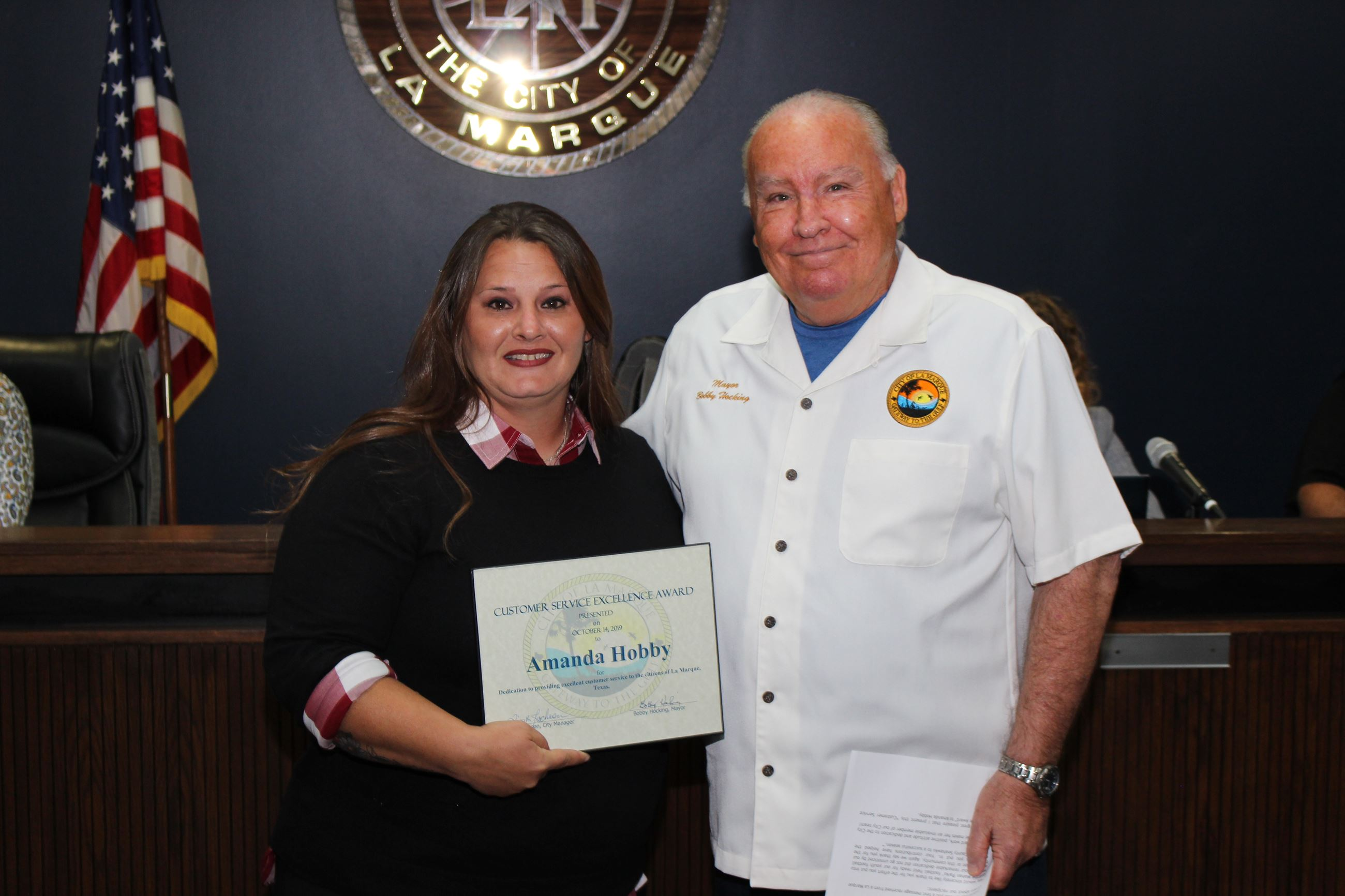 Amanda Hobby accepting Customer Service Award with Mayor Hocking